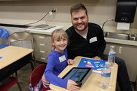 Student and parent working on an iPad