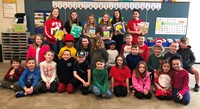 Washington students holding up books on Read Across America Day