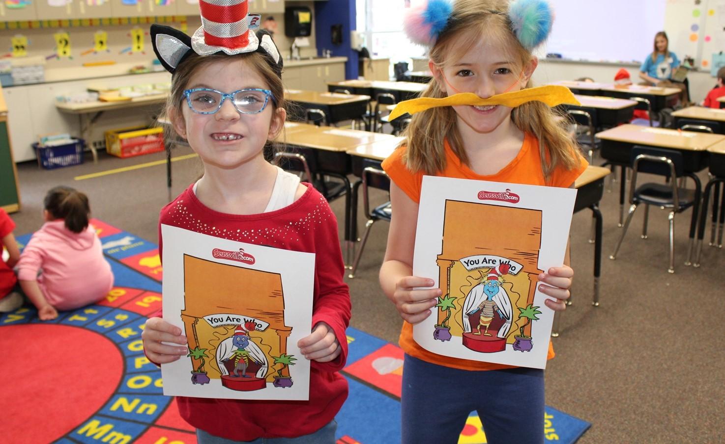 Two students with their Dr. Seuss artwork