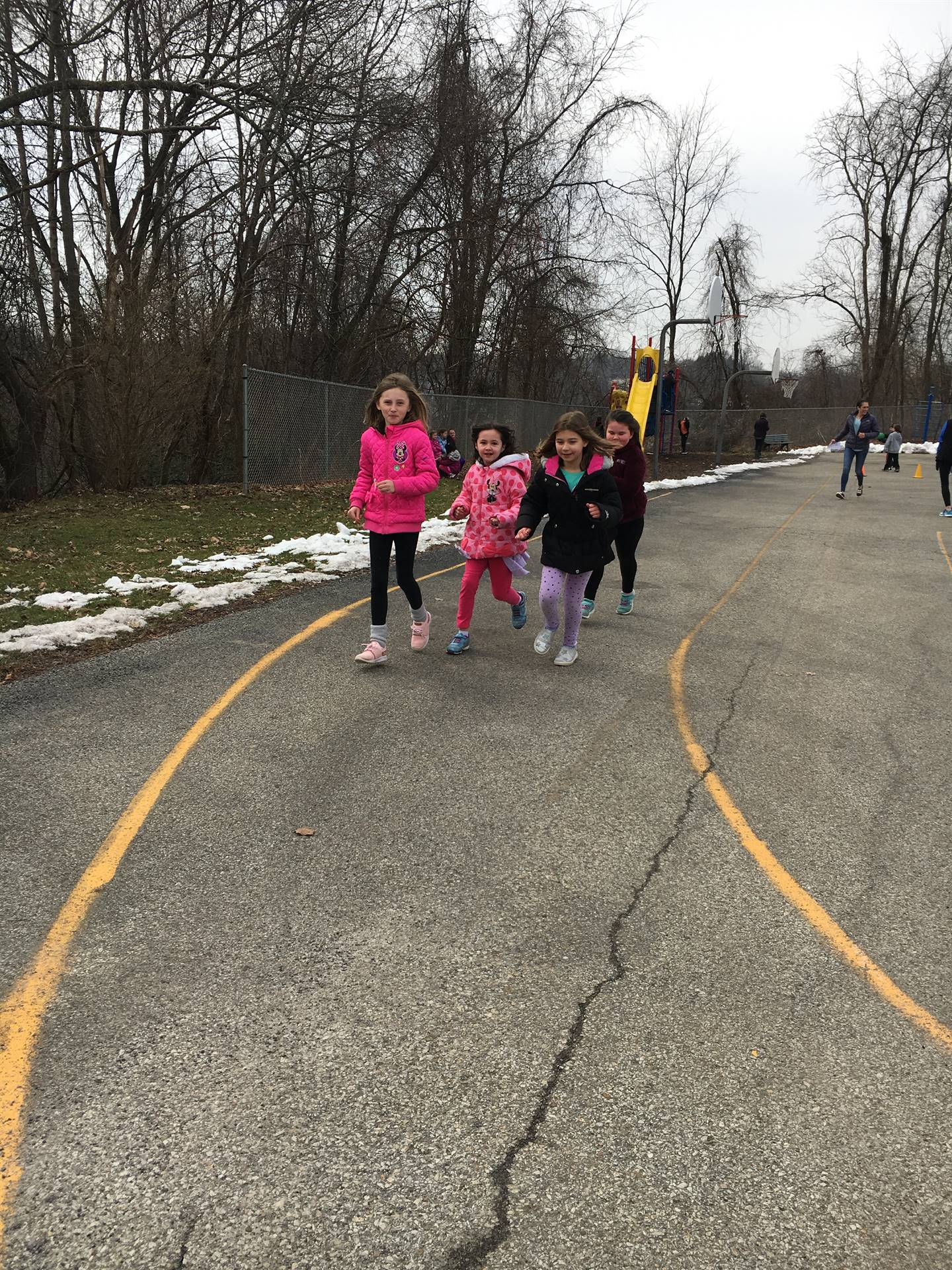 Group of students running outside