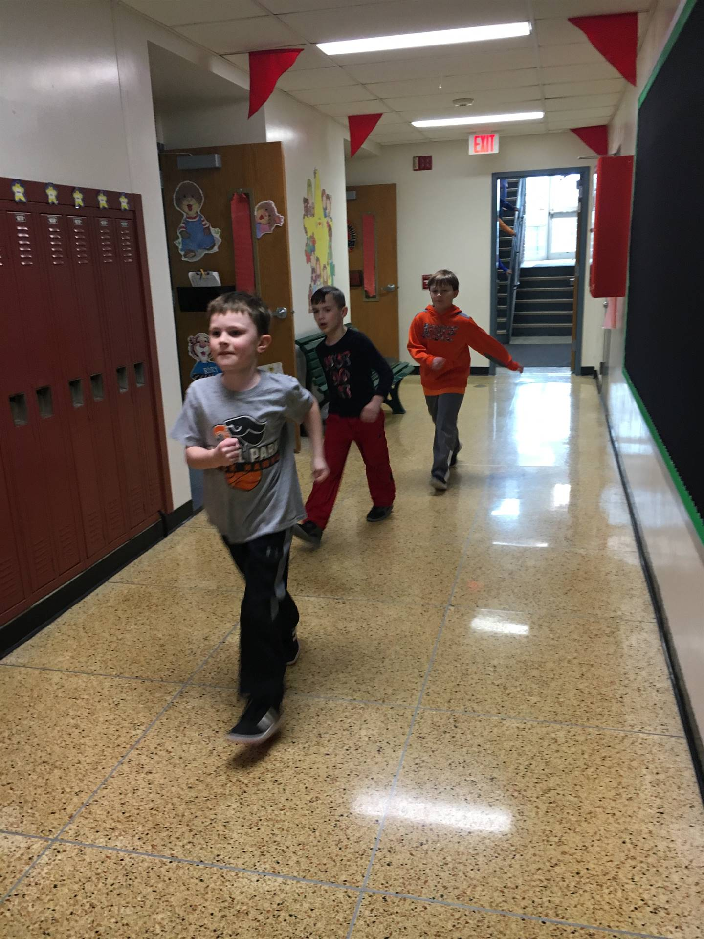 Group of students walking inside