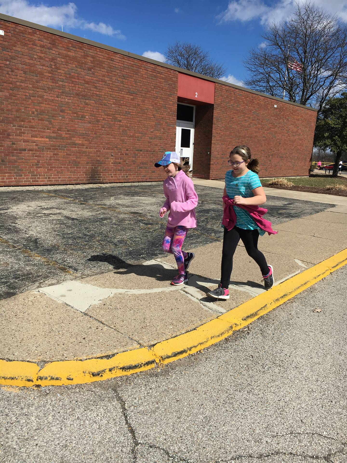 Two students running outside