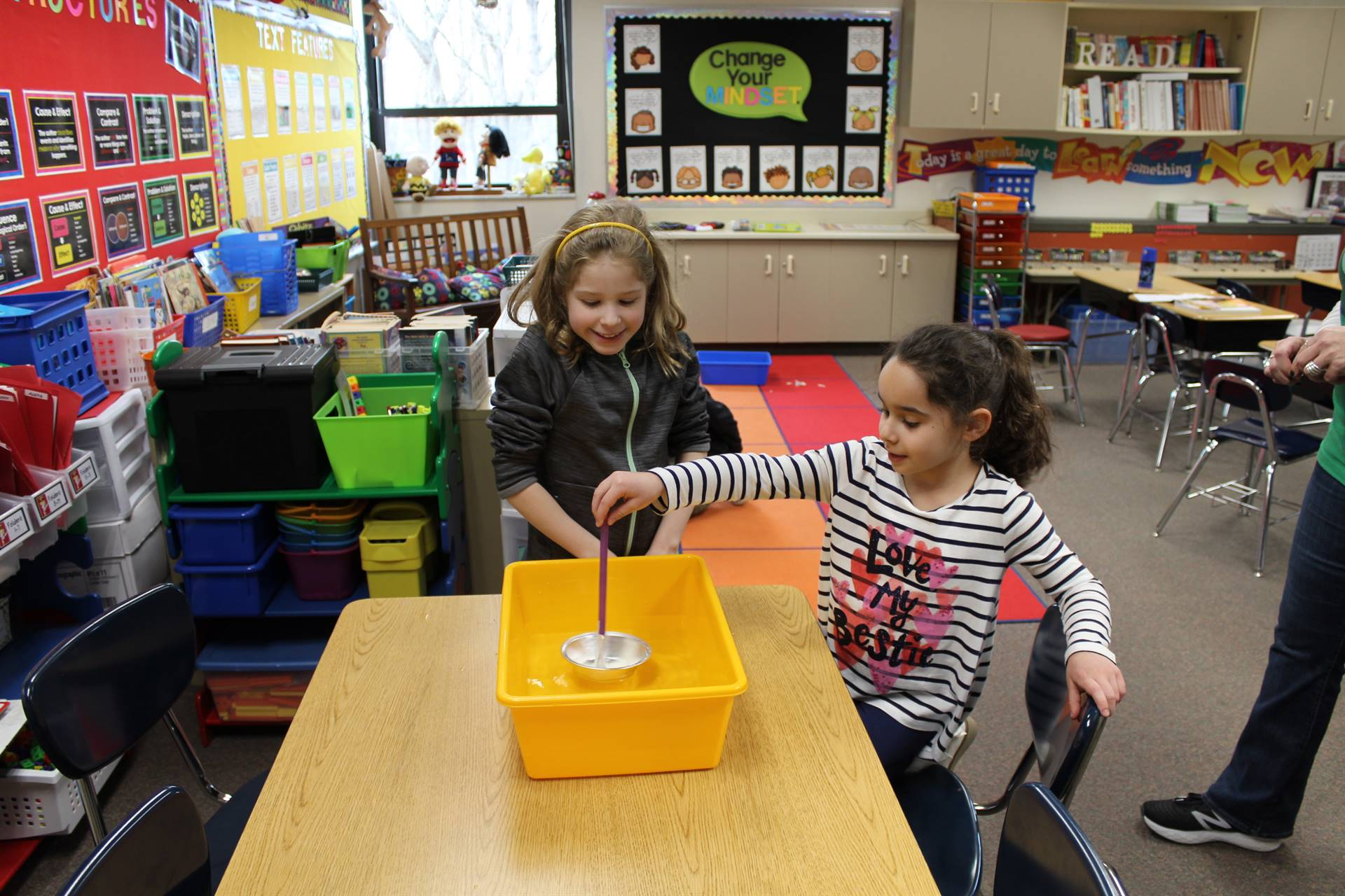 Two students checking out their boat to see if it floats