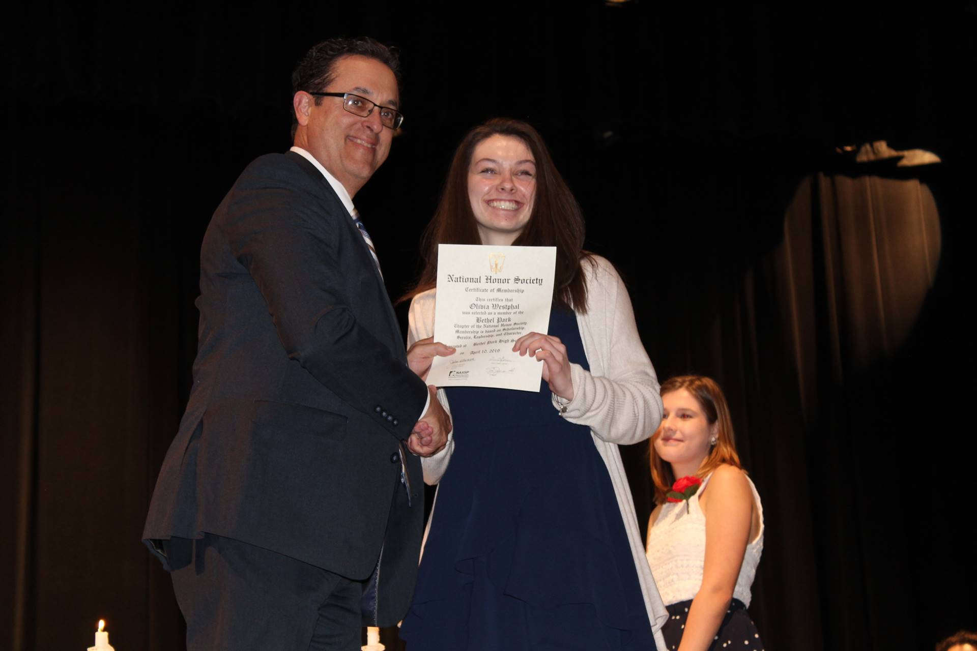 Student getting inducted into the National Honor Society