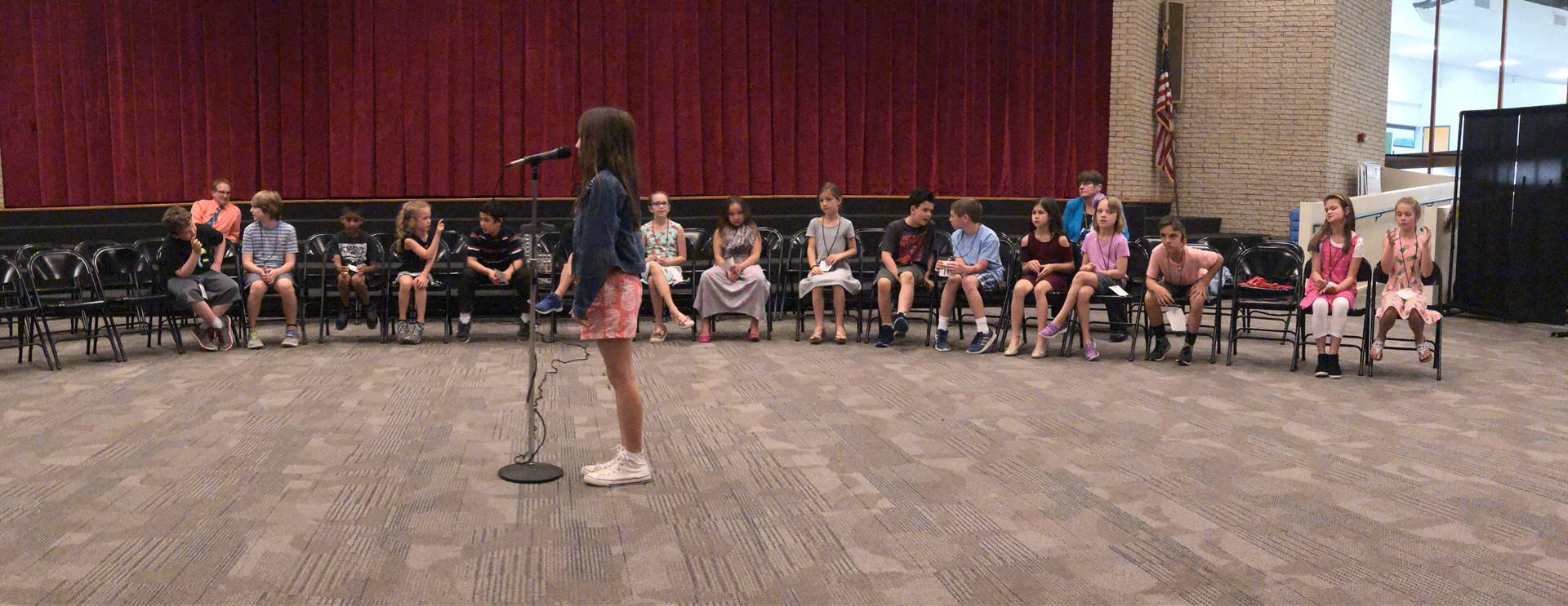 panoramic shot of a speller with the competitors in the background