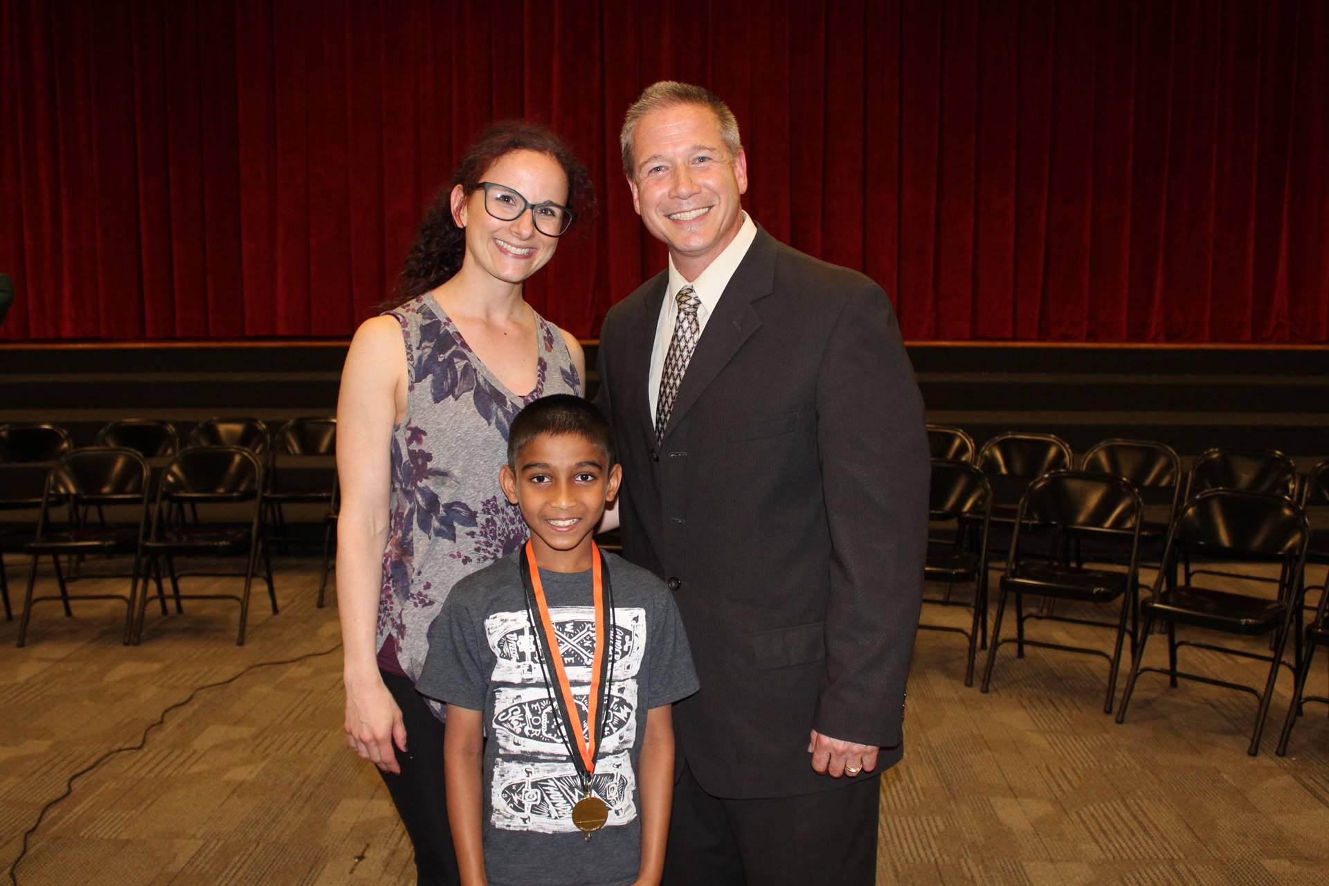 The Winner, his teacher and principal