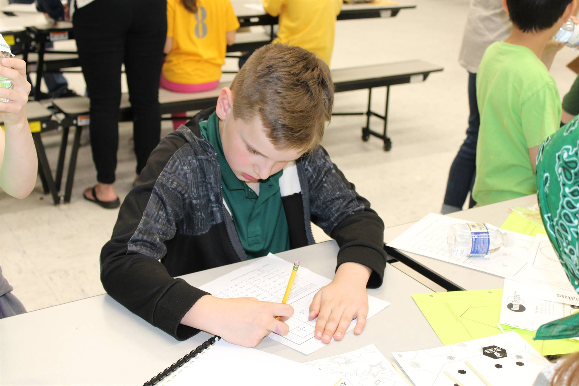 Lincoln student working on a puzzle