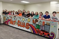 The students with the Fifth Grade Mural
