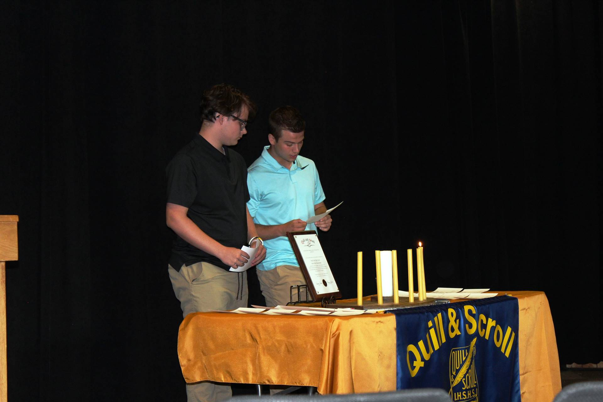 Two students participating in the candle lighting ceremony