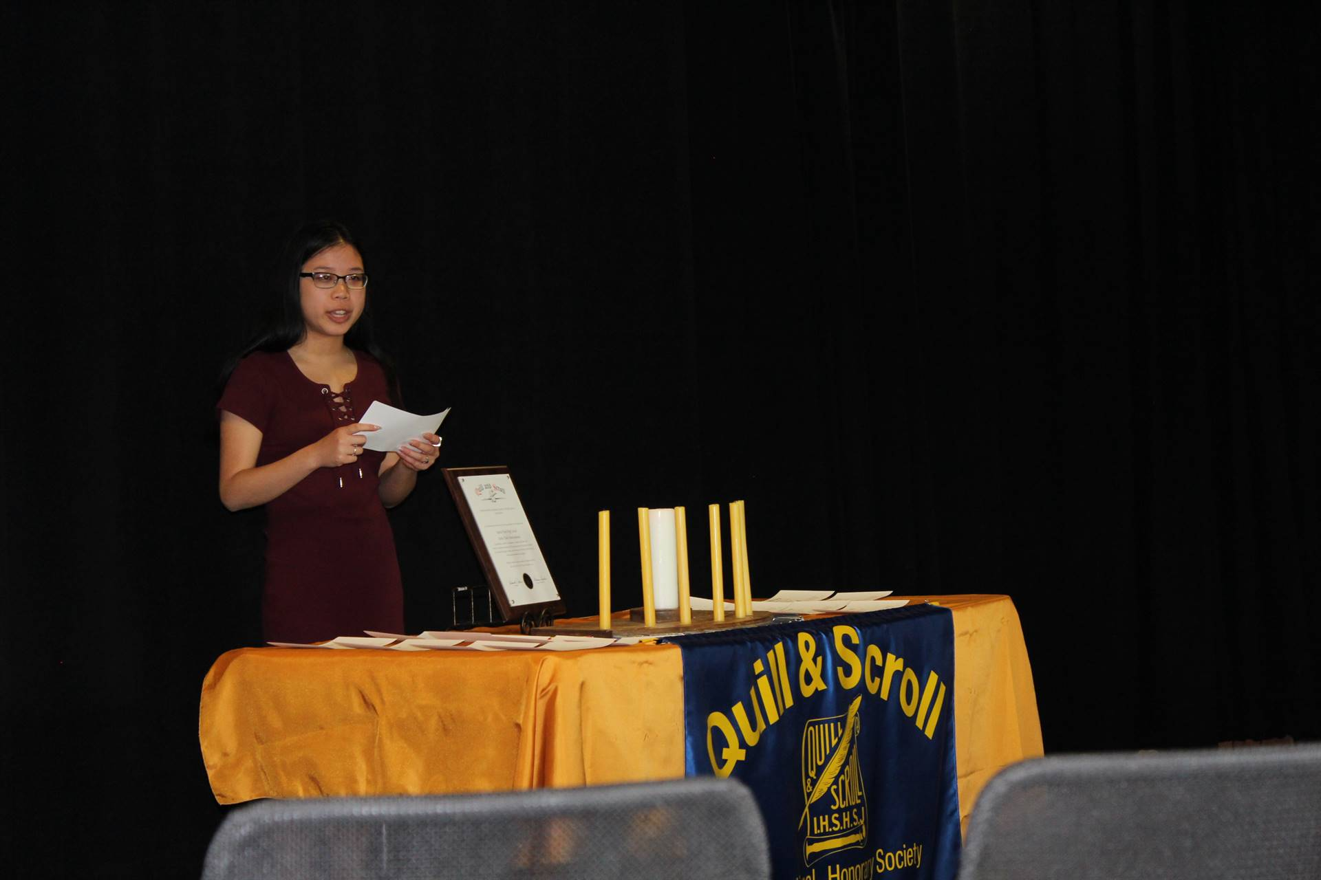 Student participating in the candle lighting ceremony