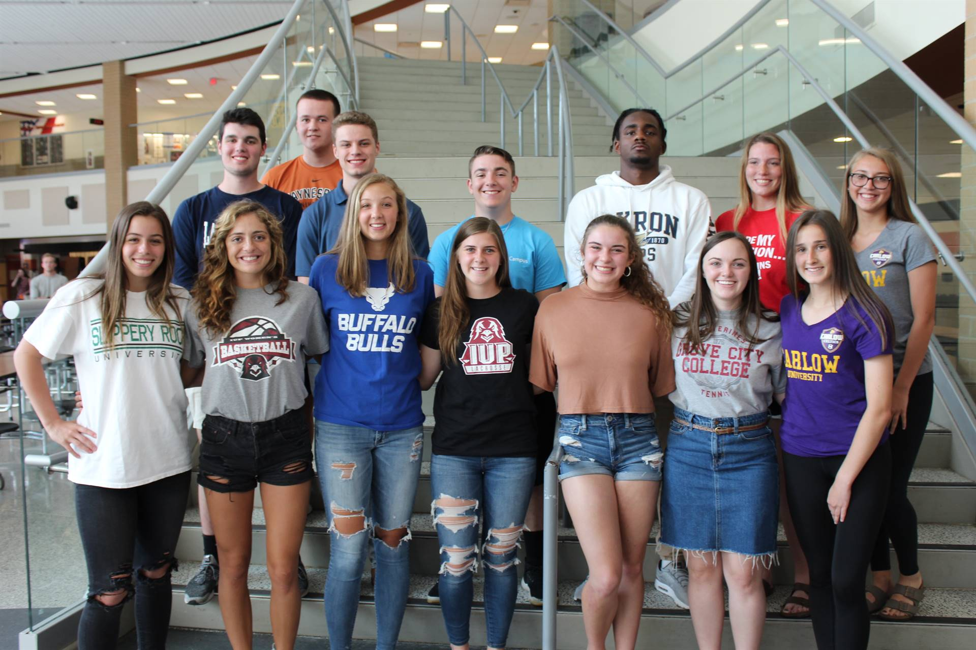 14 of the 15 college-bound student-athletes