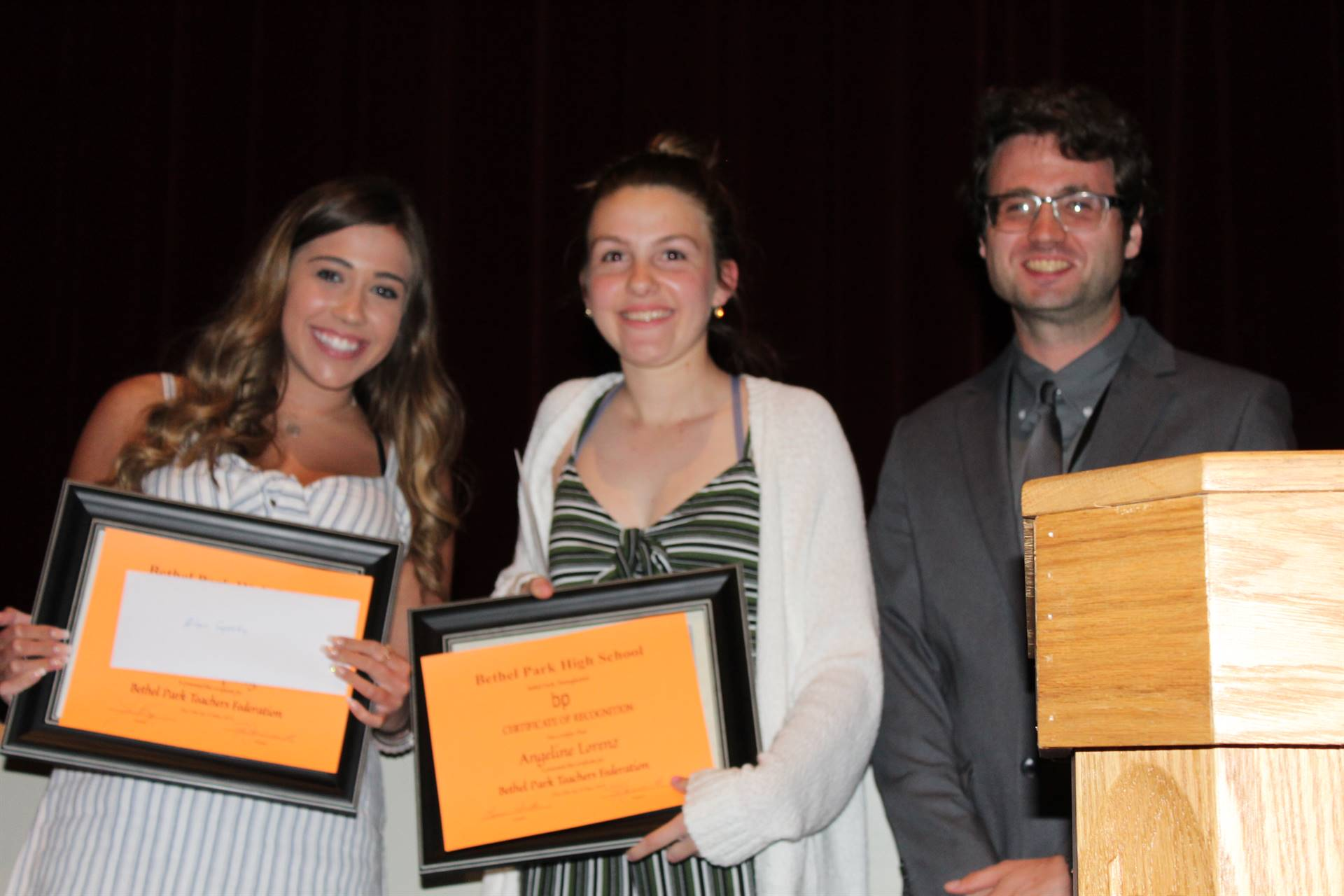 Two students receiving a scholarship