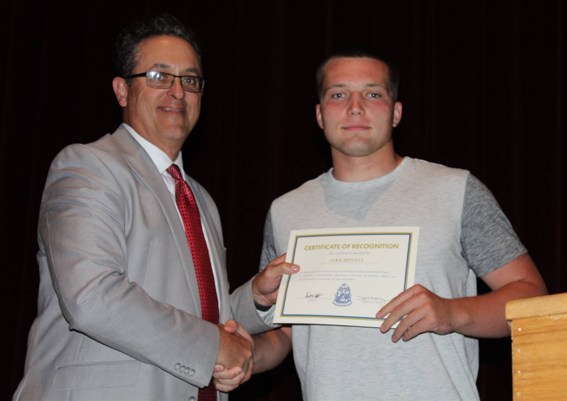 Student receiving recognition award