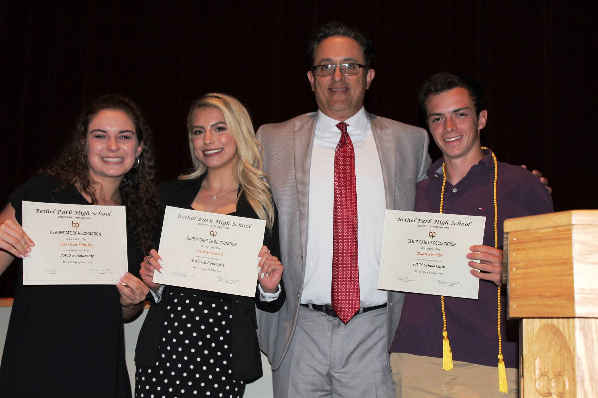 Three students receiving scholarships
