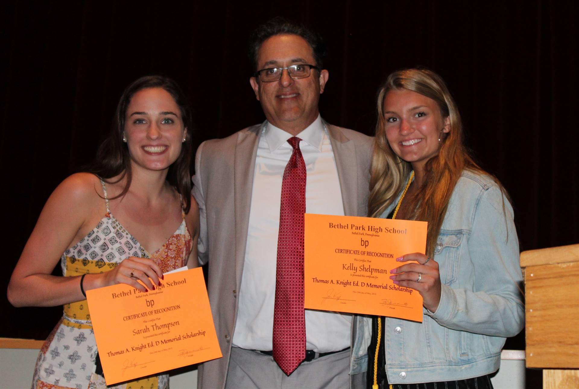 Two students receive a scholarship at Awards Night
