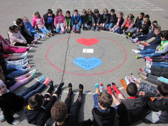 First graders sitting in a circle wearing crazy socks