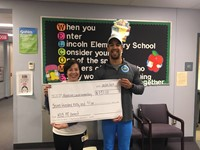 Mrs. DeGregorio and the check presentation