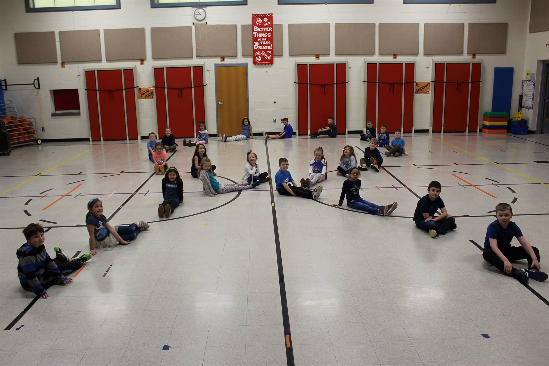 Students forming a giant Autism ribbon on the Multi-Purpose Room floor