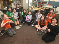 A group of girls with recycled items