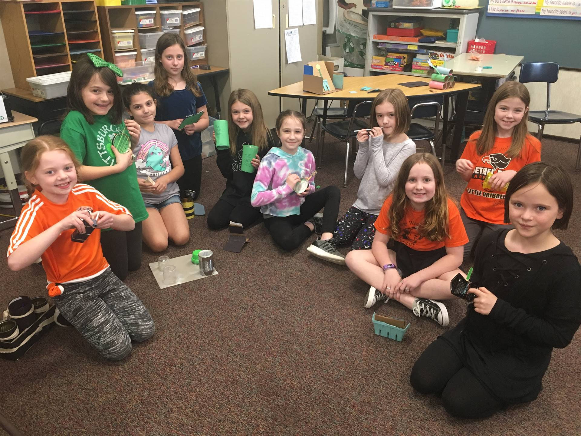 Third graders working on their recycled items