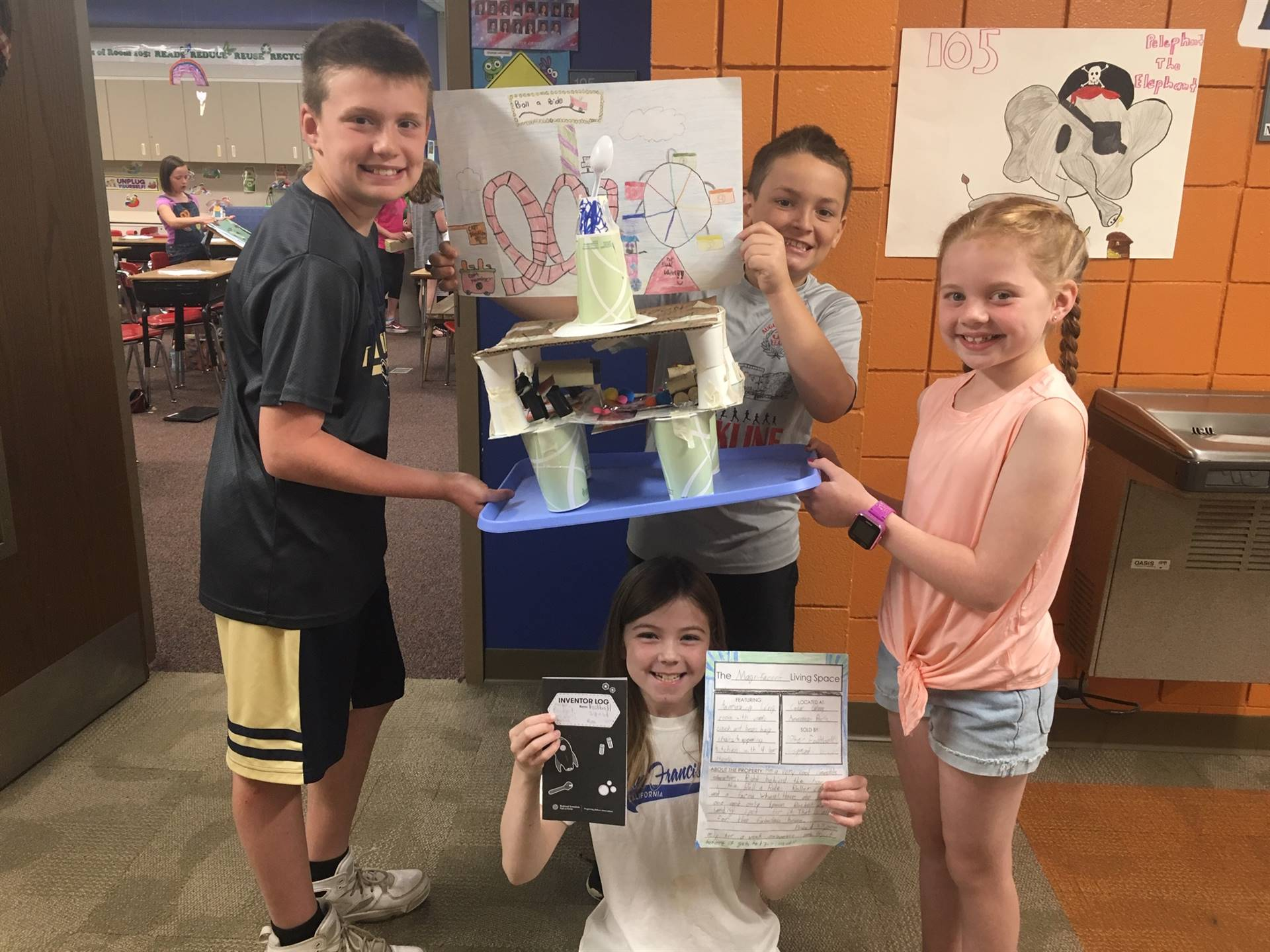 "Four students with their ""Living Spaces"" project"