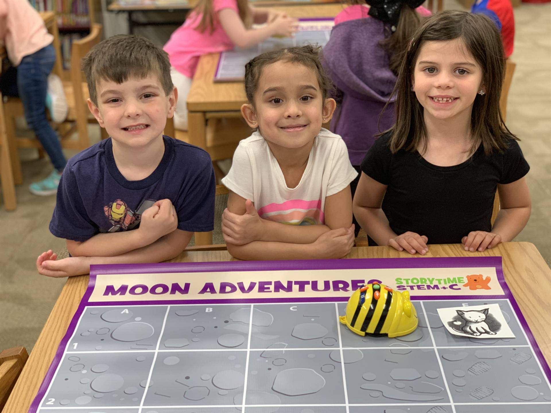 Three students with their Bee Bot