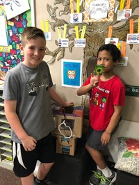 Two students with their arcade game