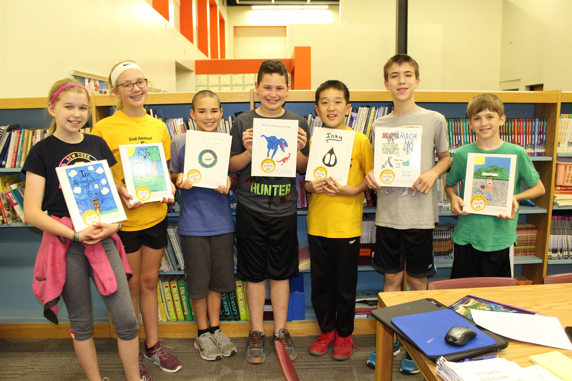 Seven GATE students with the books they wrote