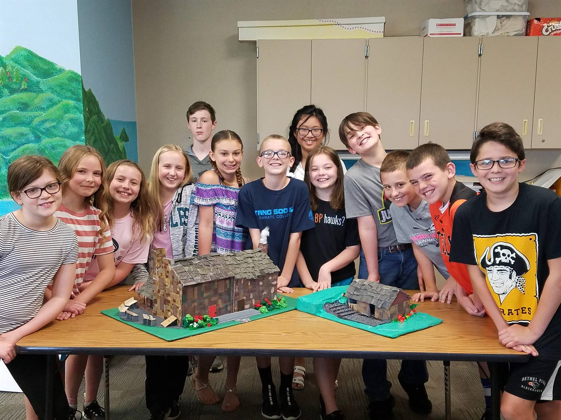 Group of students with their Oliver Miller Homestead replicas