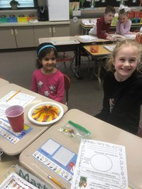 Two students with their experiment