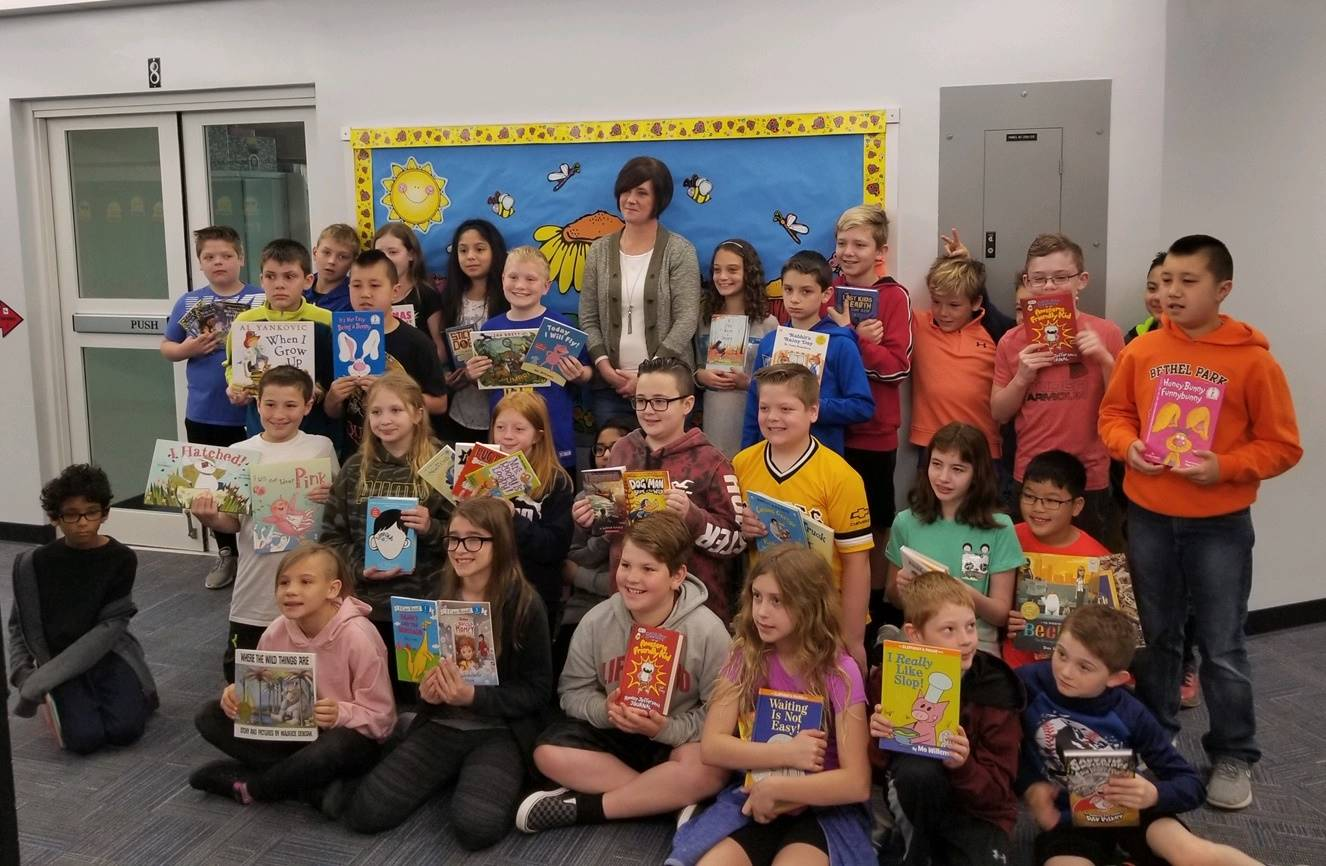 Fourth Graders with the library books they donated