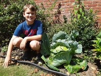 Student in the garden with his cabbage head