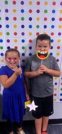 Two students in the photo booth