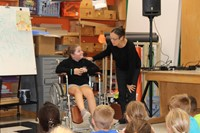 Student in a wheelchair talking to one of the presenters