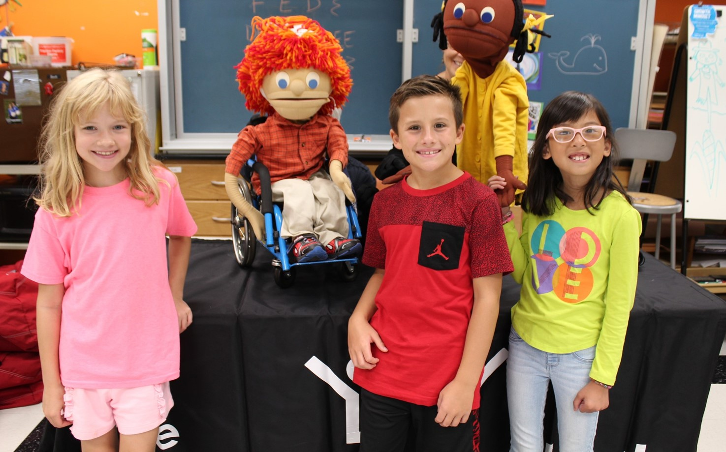 Three students and two puppets