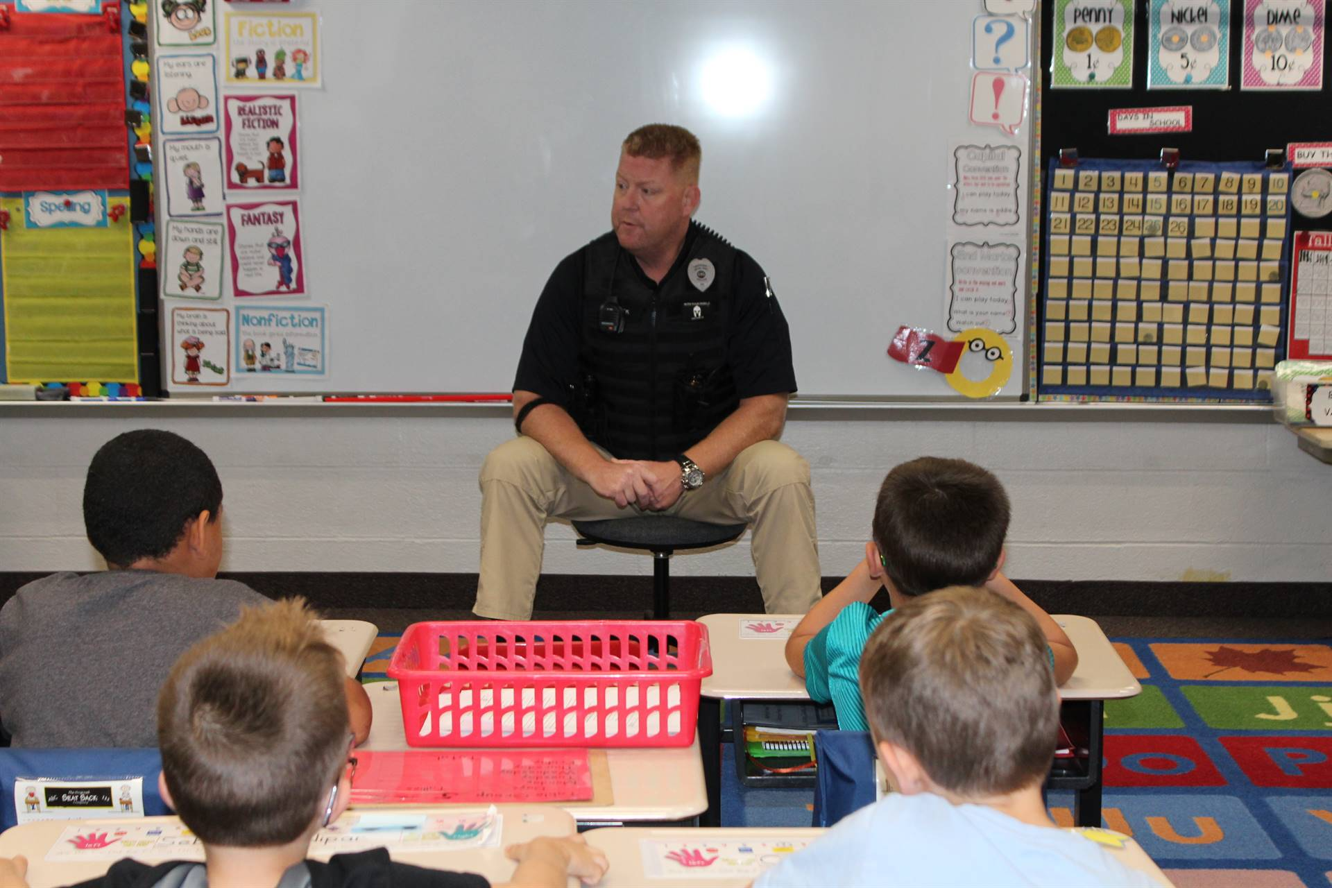 Officer Ken talking to the first graders