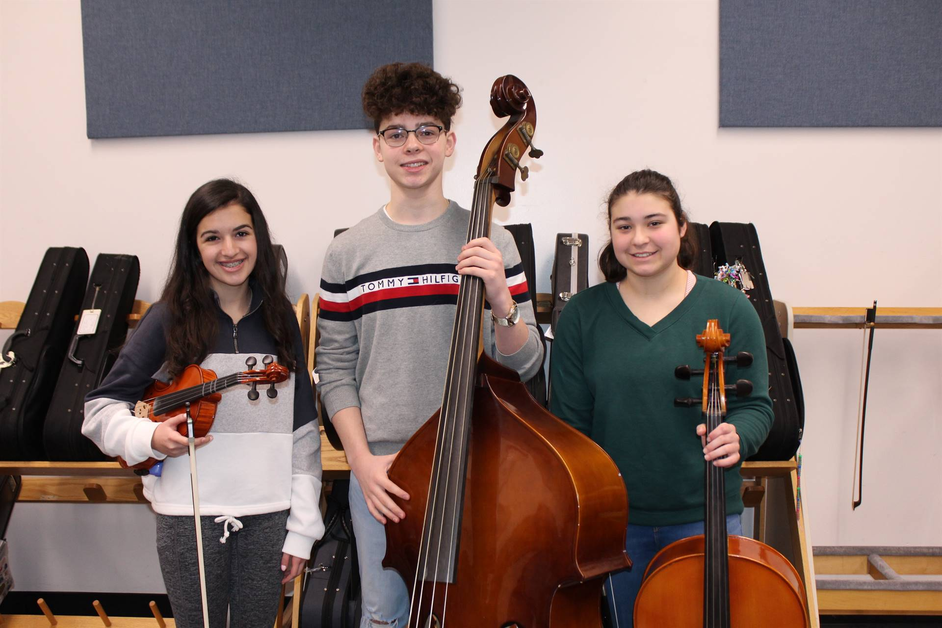 The three IMS Junior High District Orchestra musicians