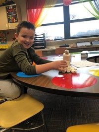 Student building his marshmallow snowman