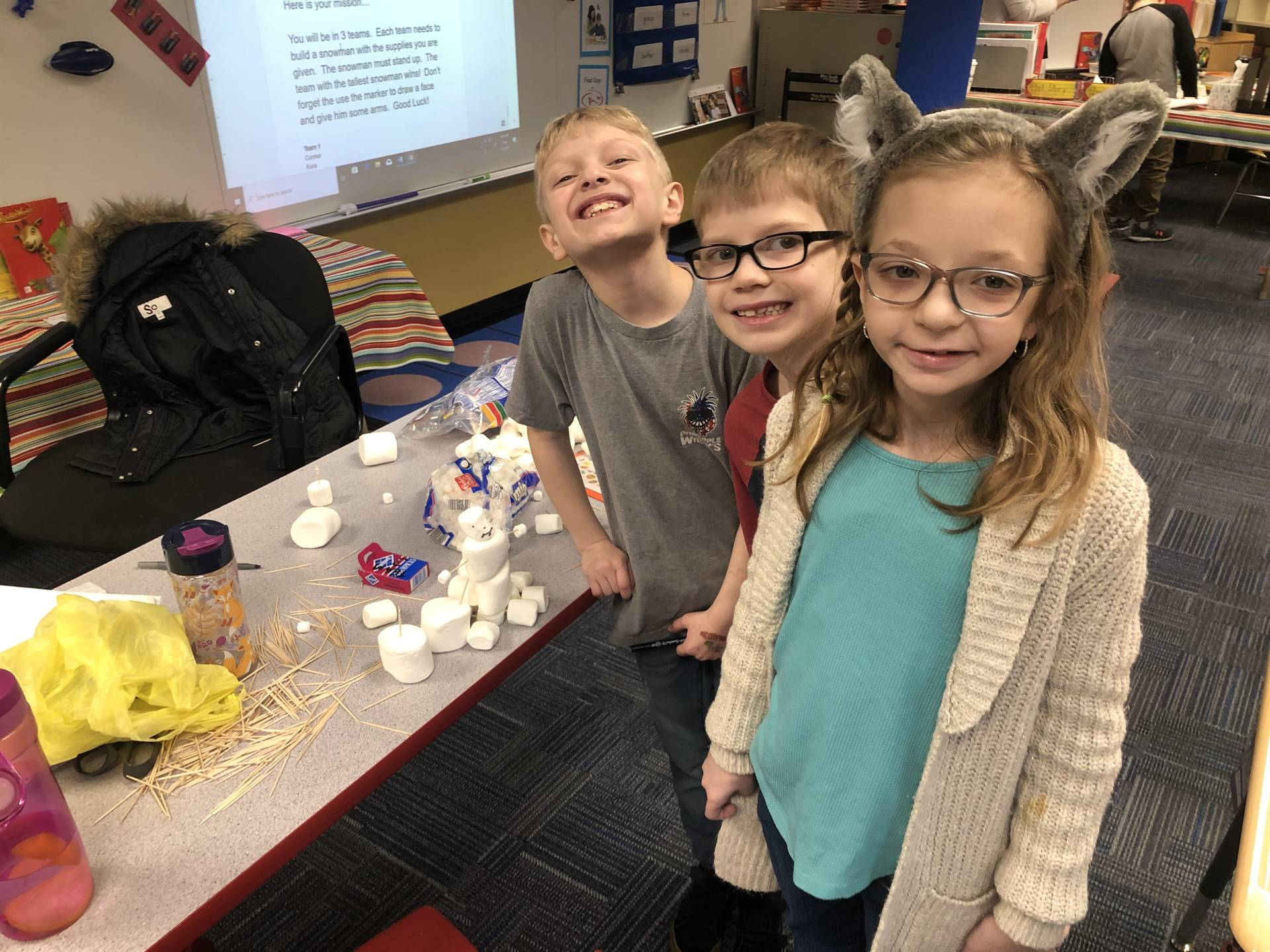 Three students with their marshmallow snowman