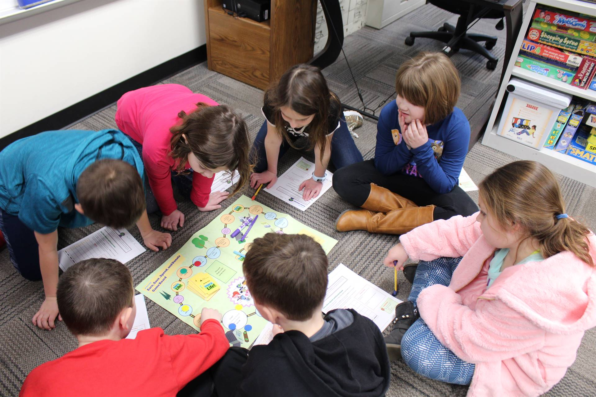 Seven students playing a game
