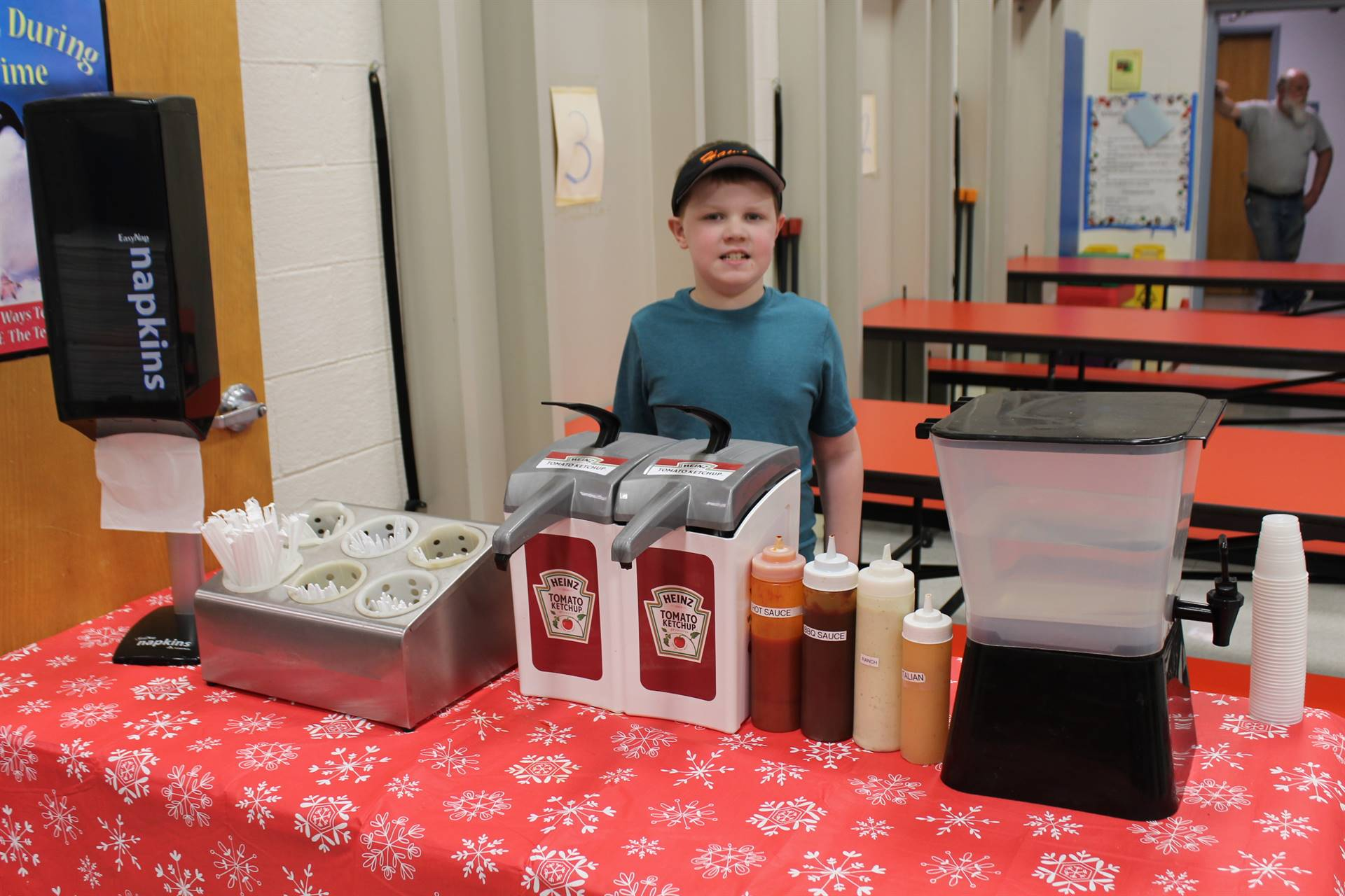 student at the condiment table in the cafeteria