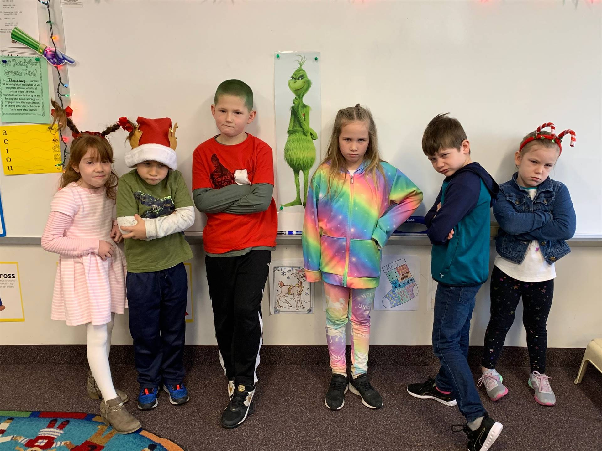 Six students making Grinch faces