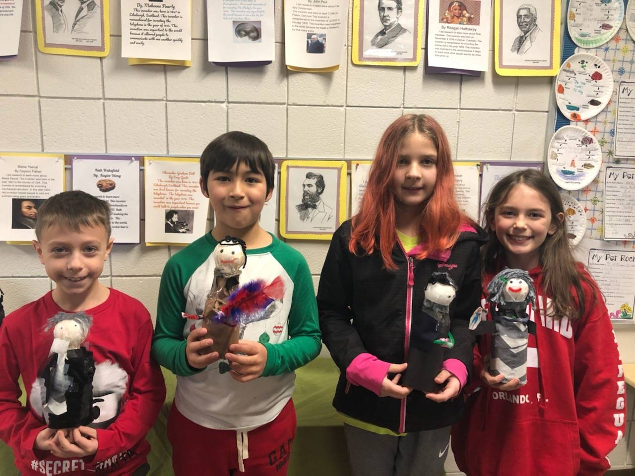 Four students with their bottle creations