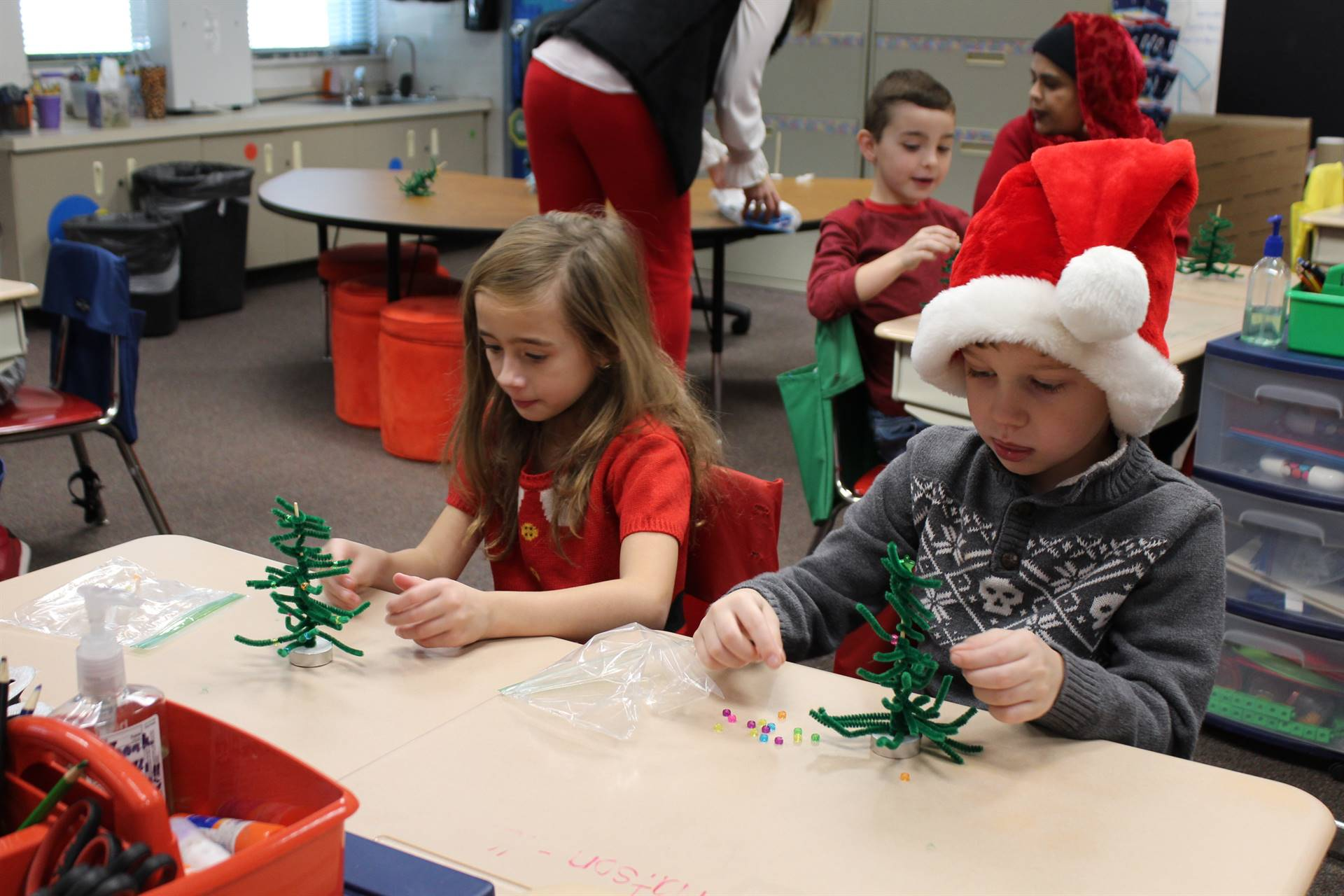 Two students making Christmas trees