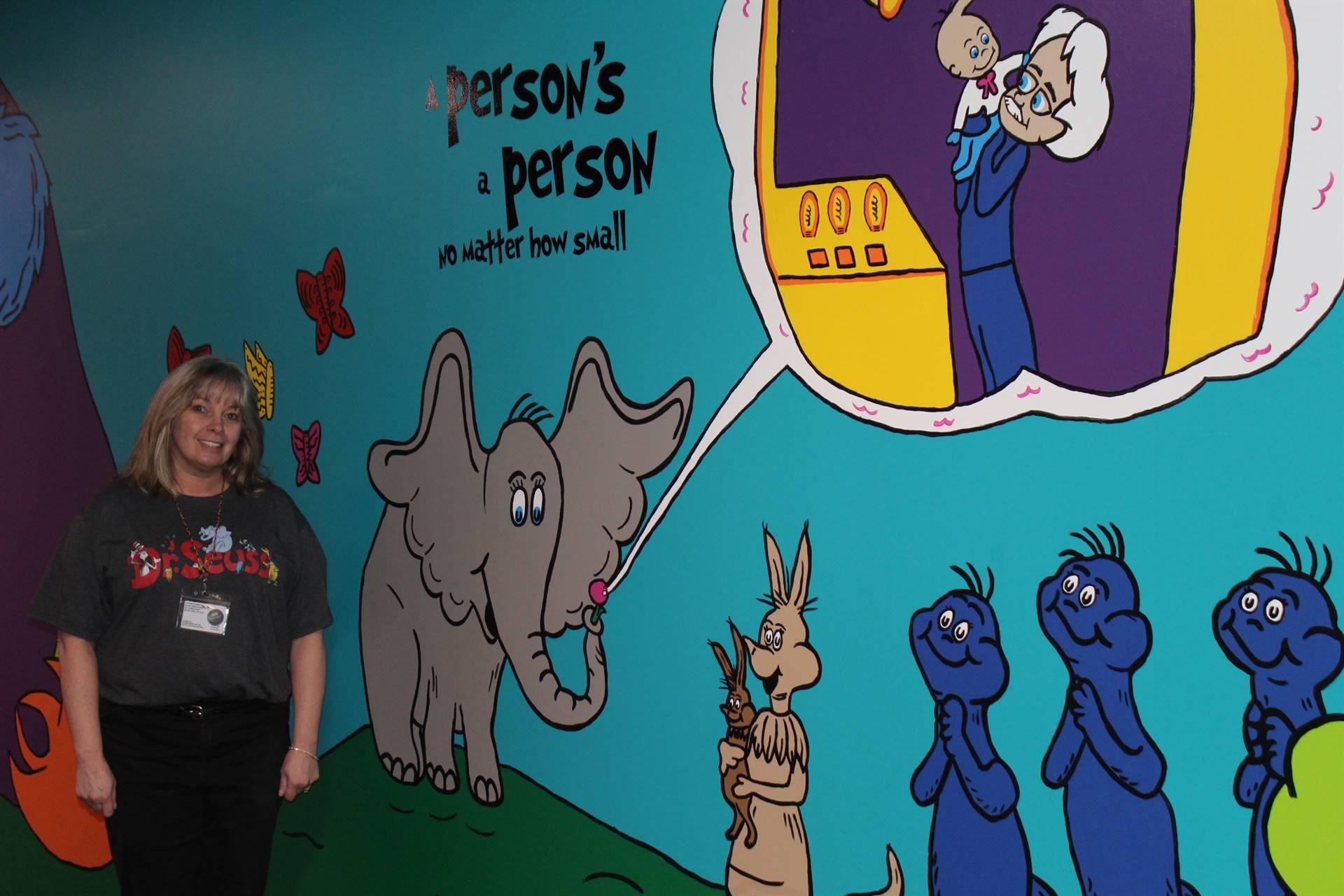 Mrs. Eckert-Graffam by the wall