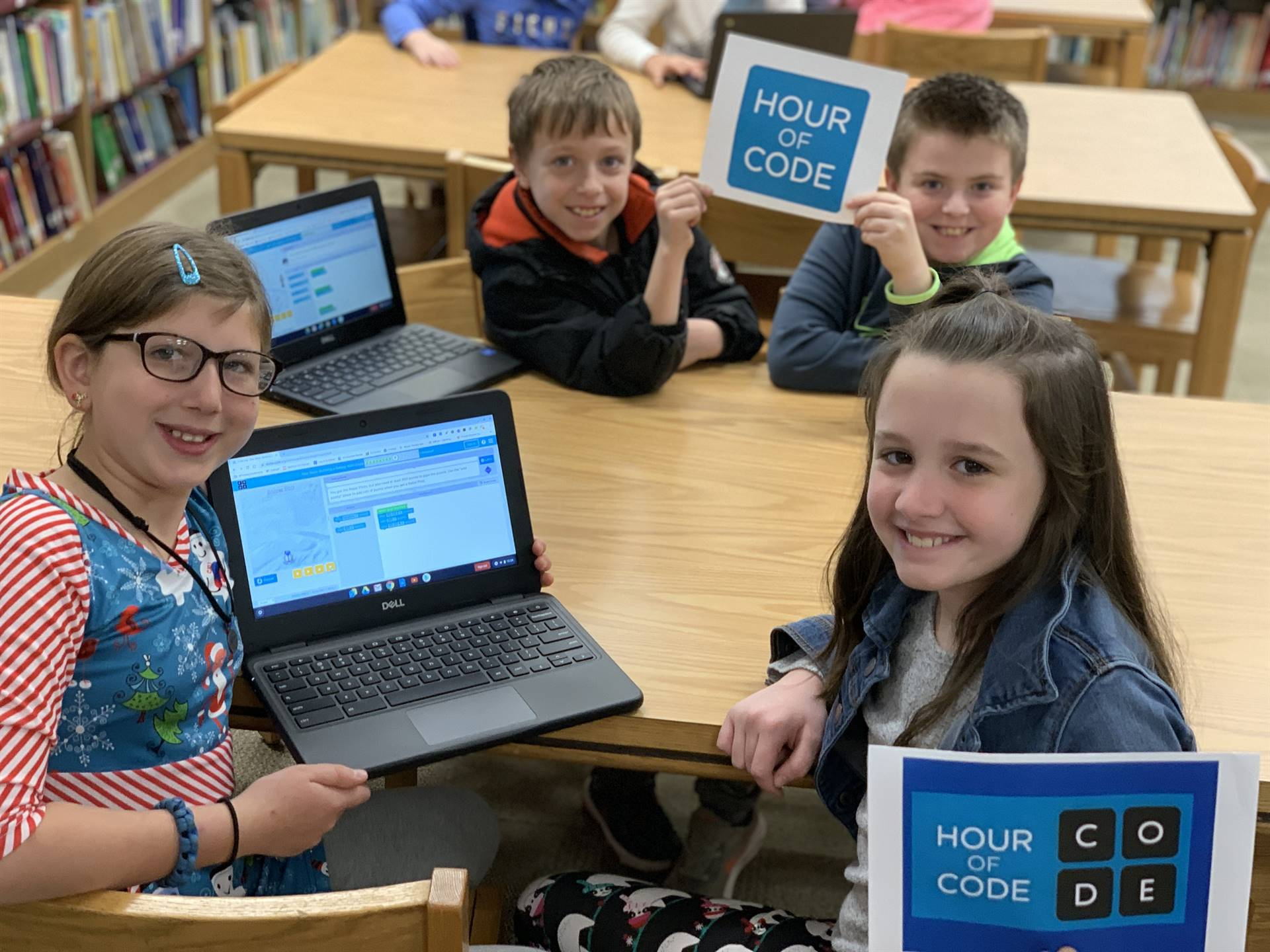 Four students with two computers