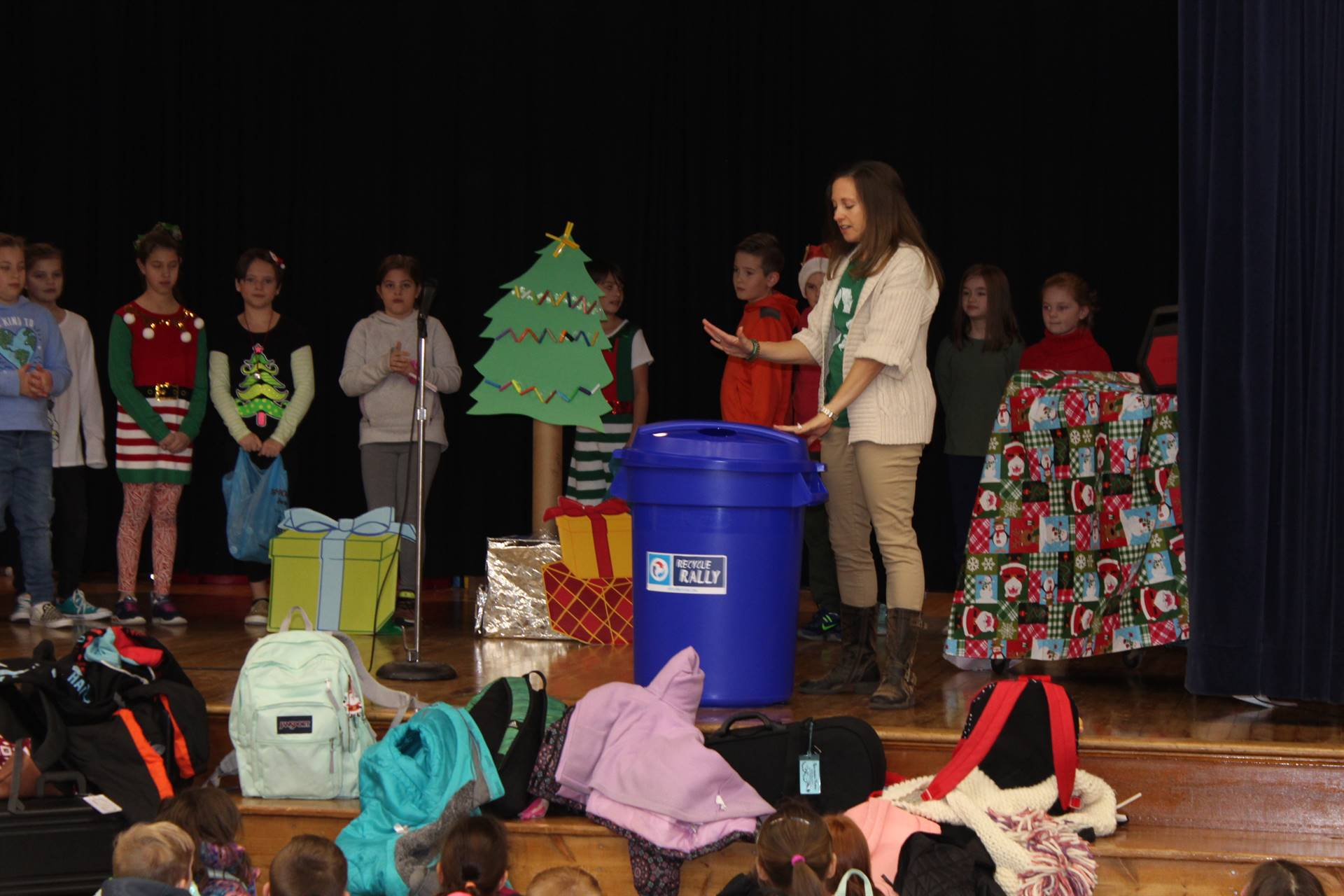 Mrs. Williams showing off the recycling container