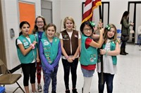 Six Girl Scouts getting ready to present the American flag