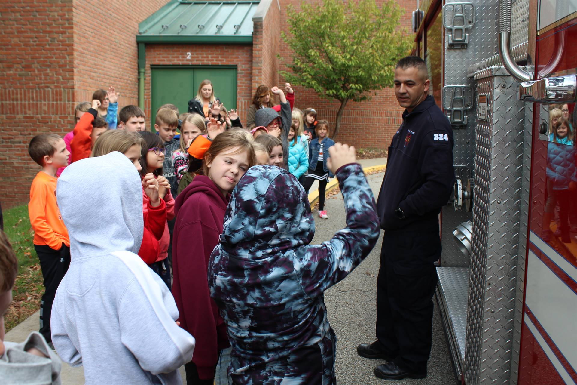 Fireman talking to students