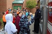 Fireman talking to students